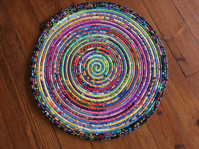 Bright! rug made of NC cotton rope and fabric scraps from local quilters.